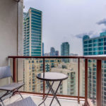 85 Bloor Unit 1814 balcony with glass-panels, round table and two chairs.