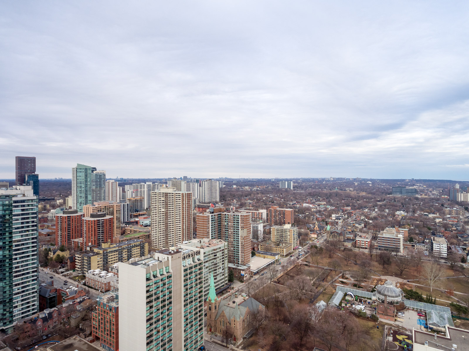 Aerial view of Church-Yonge Corridor during winter with buildings and parks.