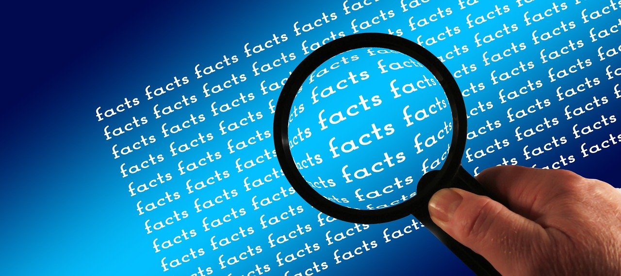 "Black magnifying glass examining the word ""facts"" showing facts behind 2020 spring market."
