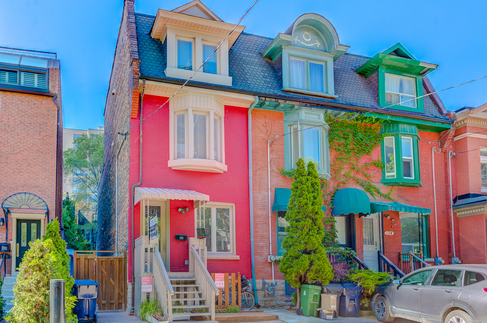Row of colourful 3-storey Victorian houses in Toronto.