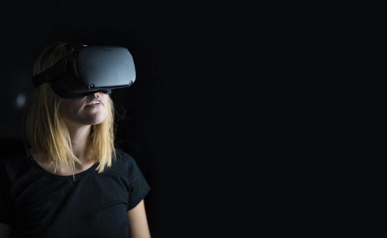 Young woman wearing virtual reality headset to show virtual tours during COVID-19.