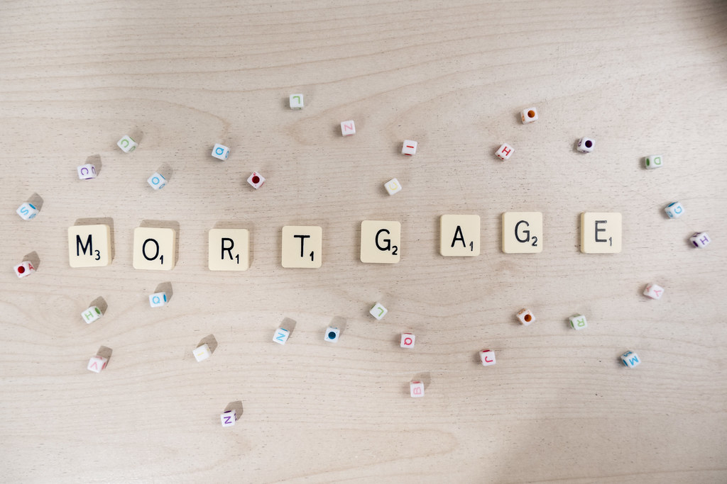 "Beige scrabble tiles spelling out word ""Mortgage."""