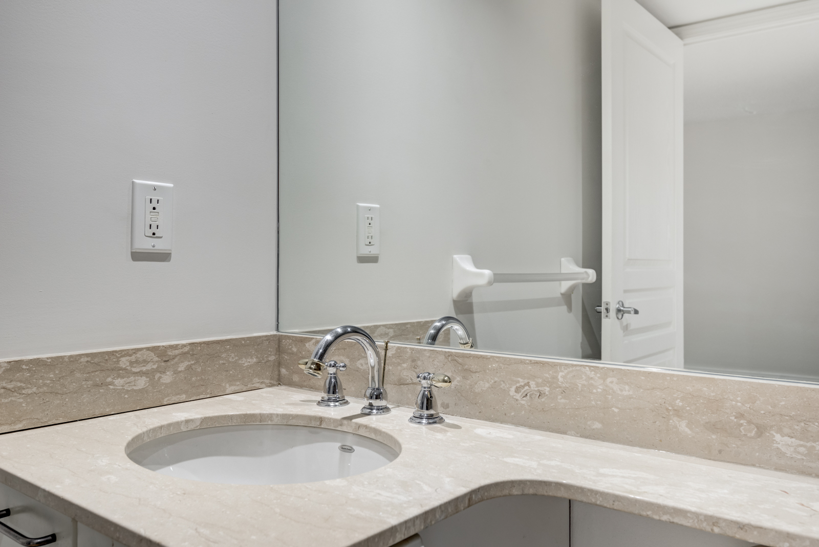 Close up of bathroom sink with circular bowl and silver faucet.