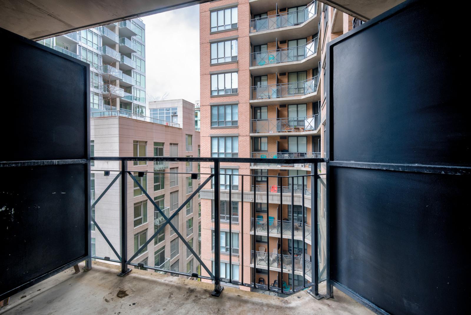 2 black dividers plus iron railing of balcony.