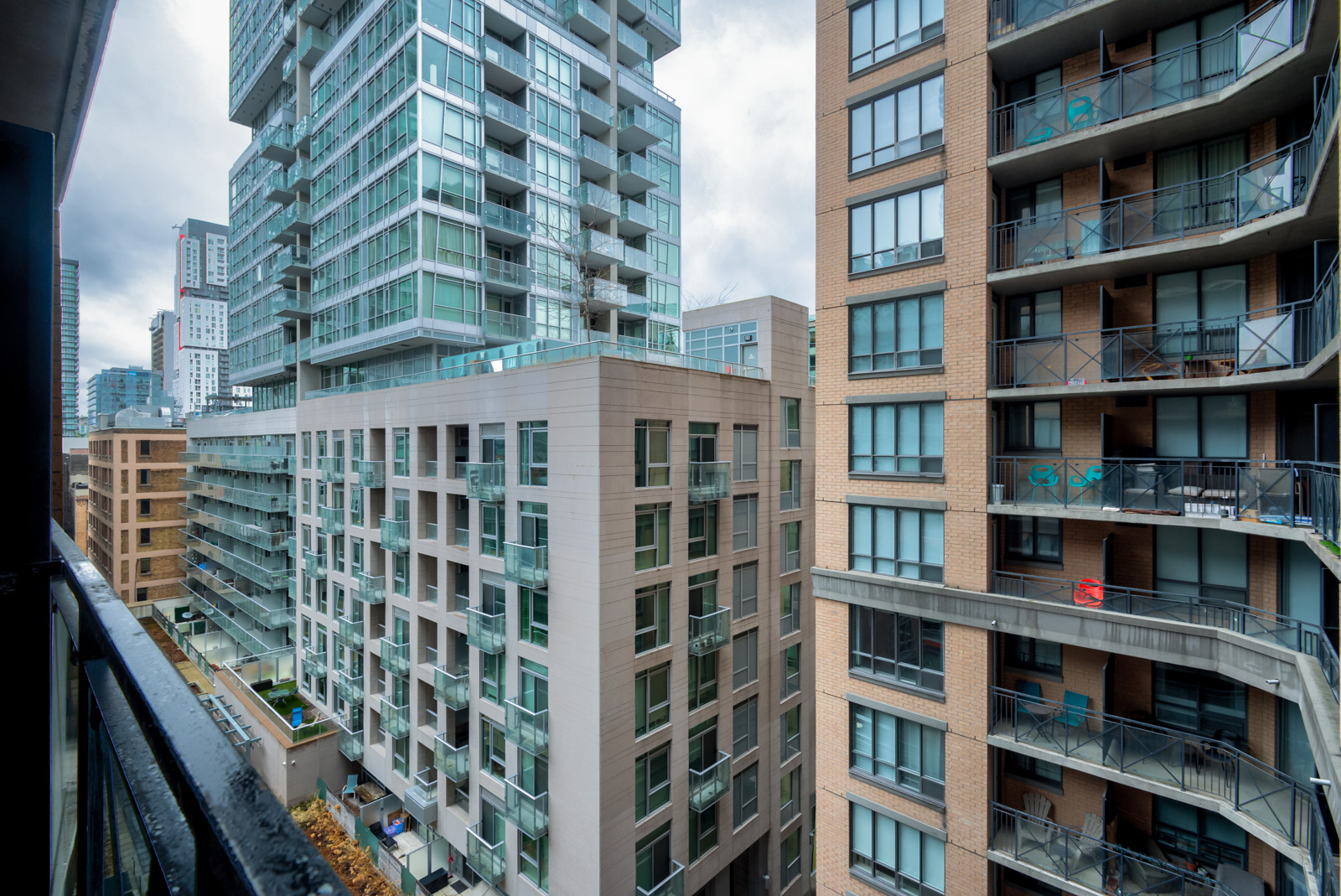View of neighbouring buildings from balcony of 140 Simcoe St E Unit 921.