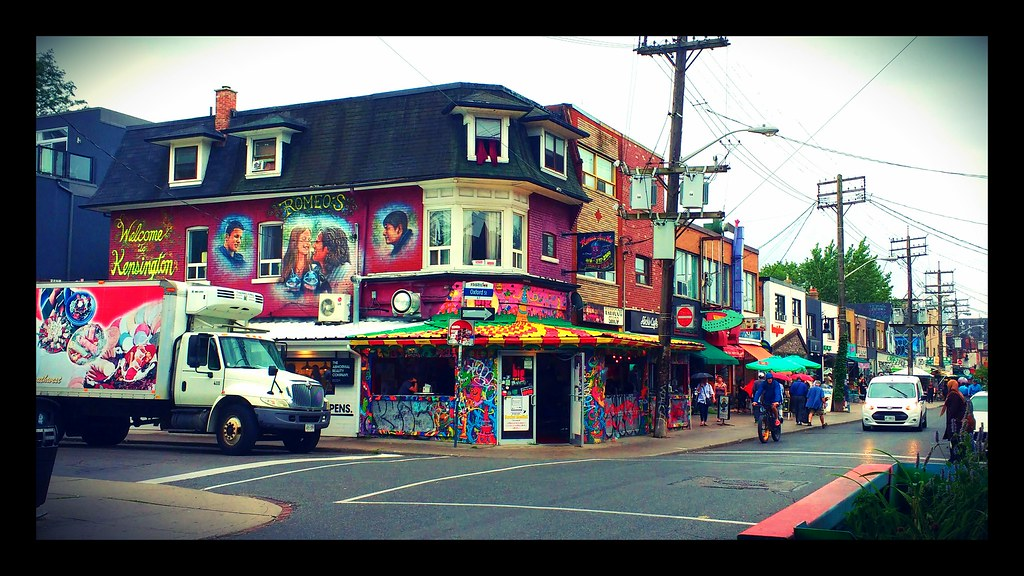 Streets, shops and graffiti along Kensington Market, Toronto.