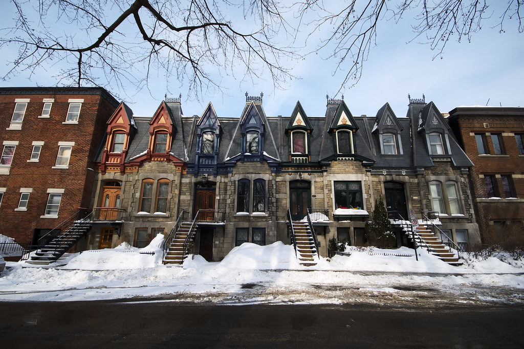 Victorian row houses with snow-covered pavements,