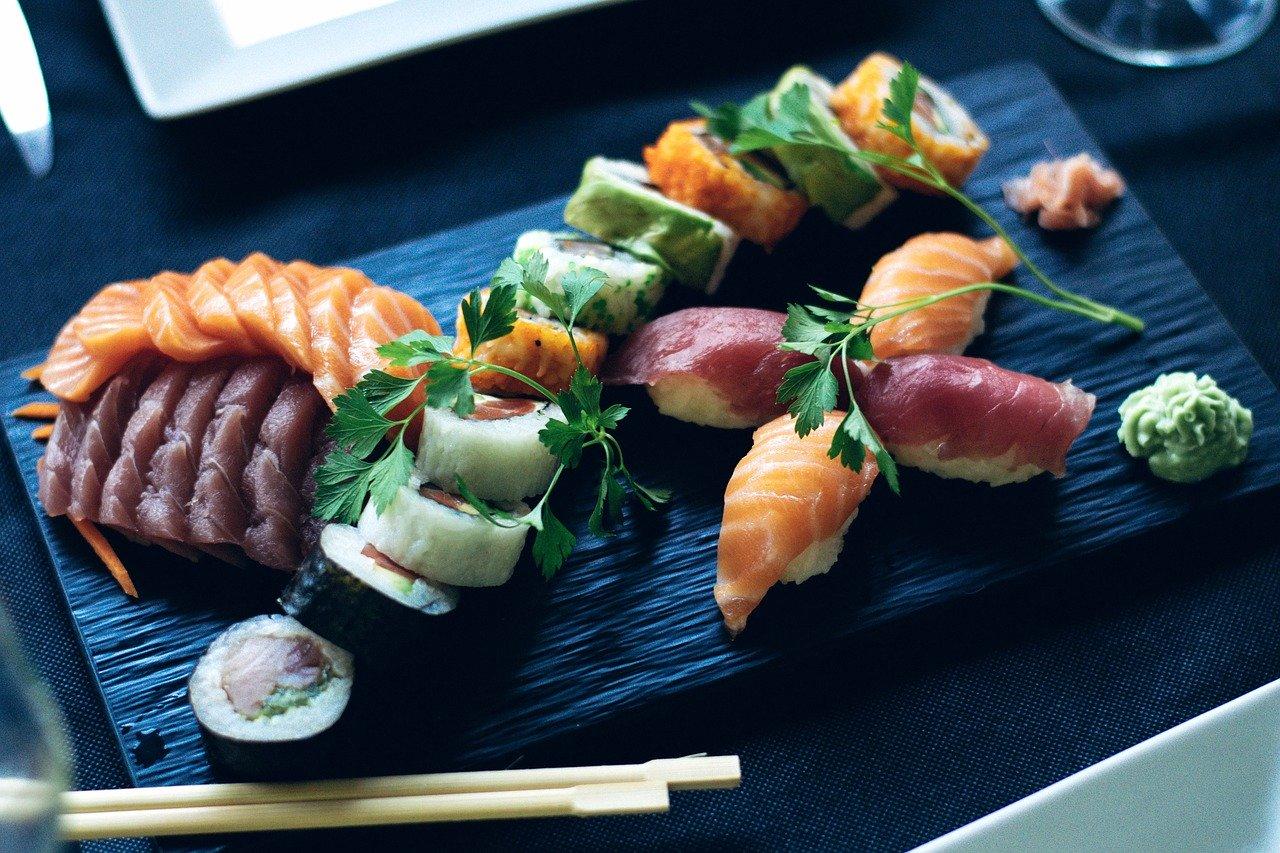 Sushi platter with shrimp and garnish.