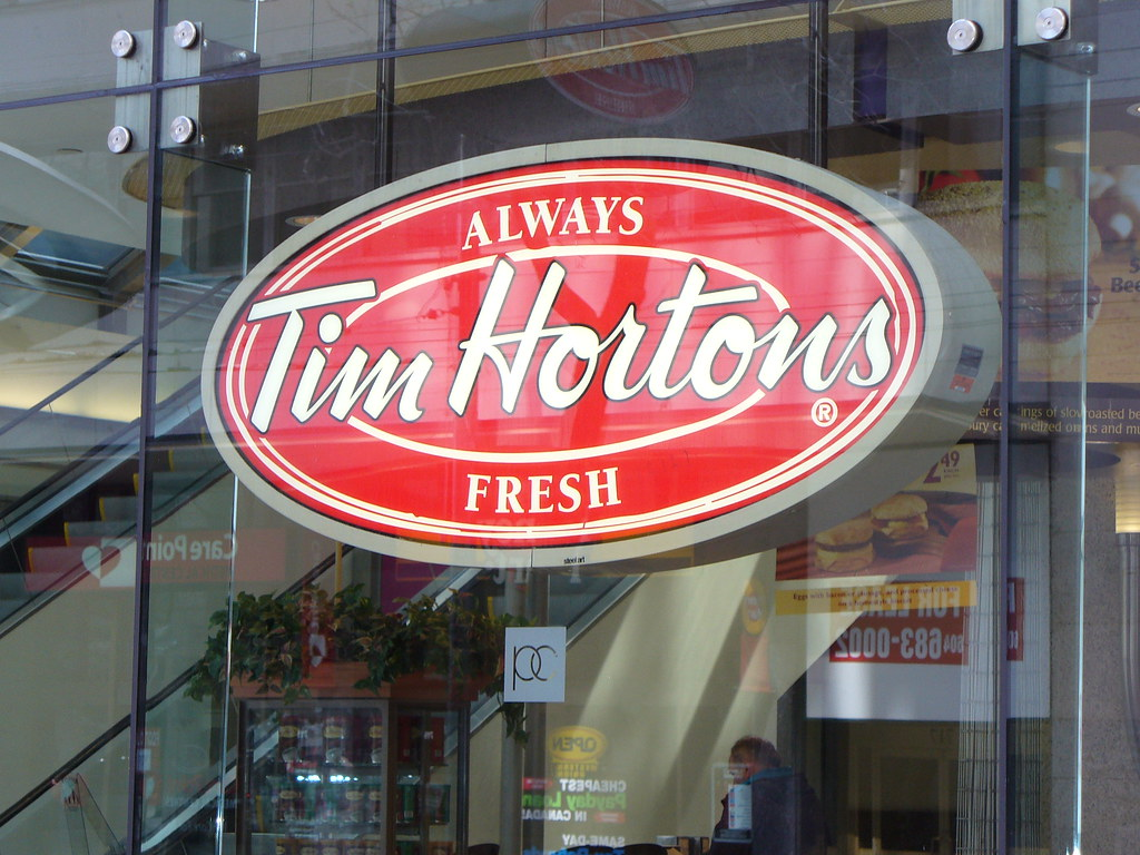 """Large red and white Tim Hortons sign saying """"Always Fresh."""""""