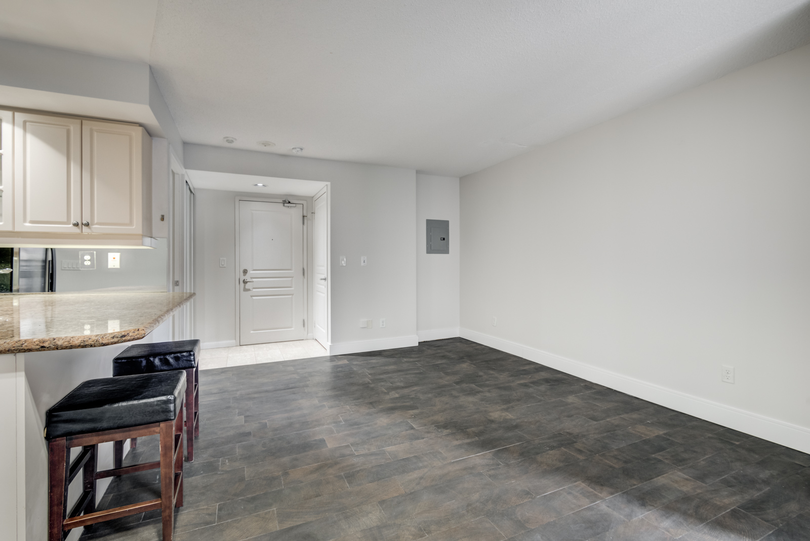 View of 140 Simcoe St E Unit 901 empty living room and bedroom.