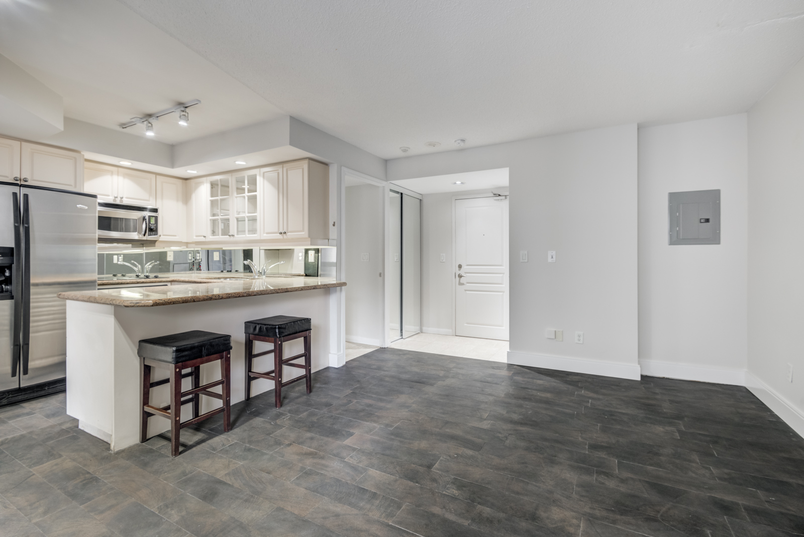 Empty condo with newly painted gray walls.