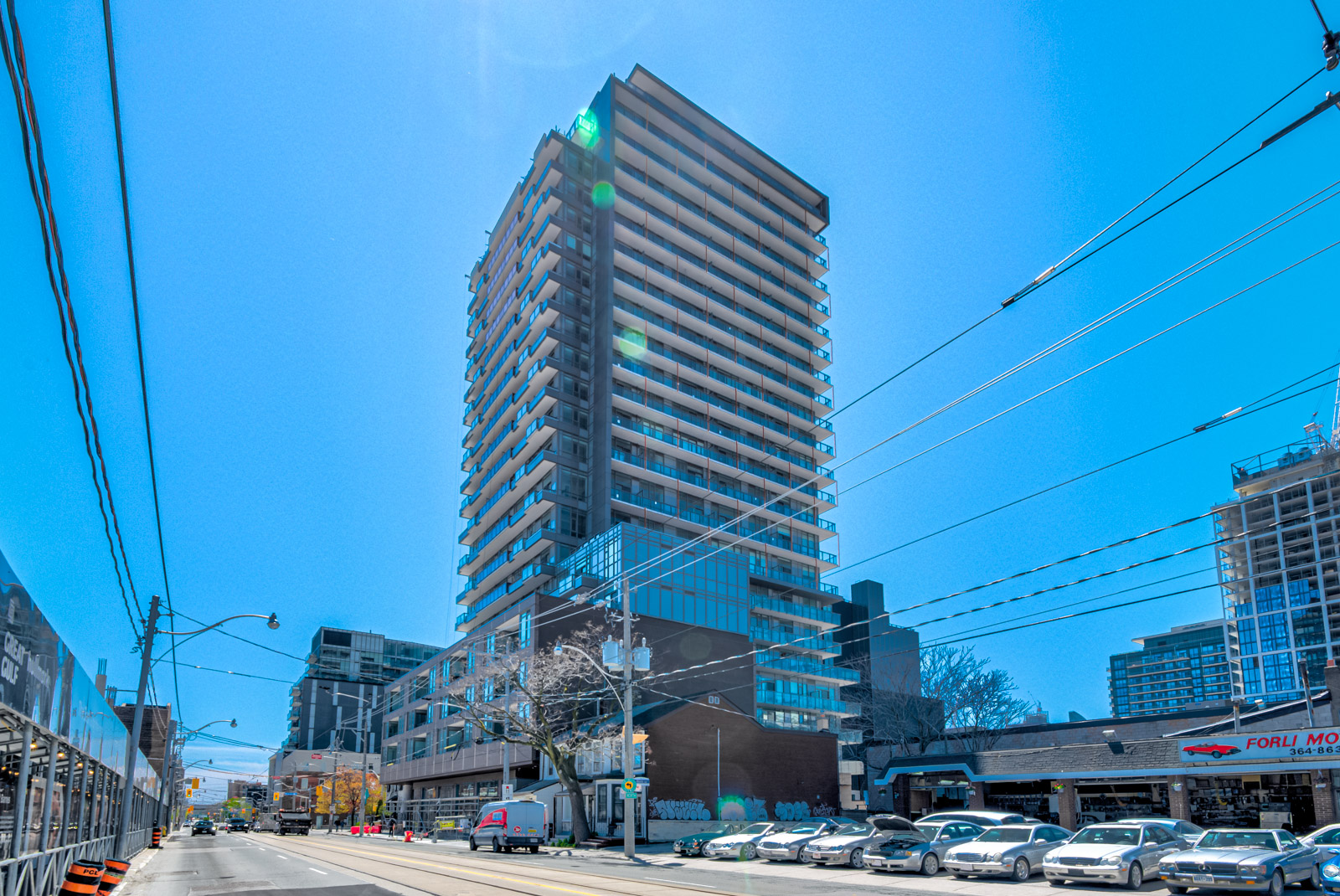 Across-the-street view of East United Condos, a mid-rise condo.