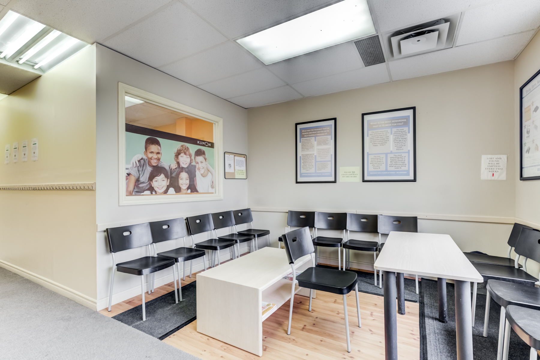 Kumon waiting area with chairs and tables.