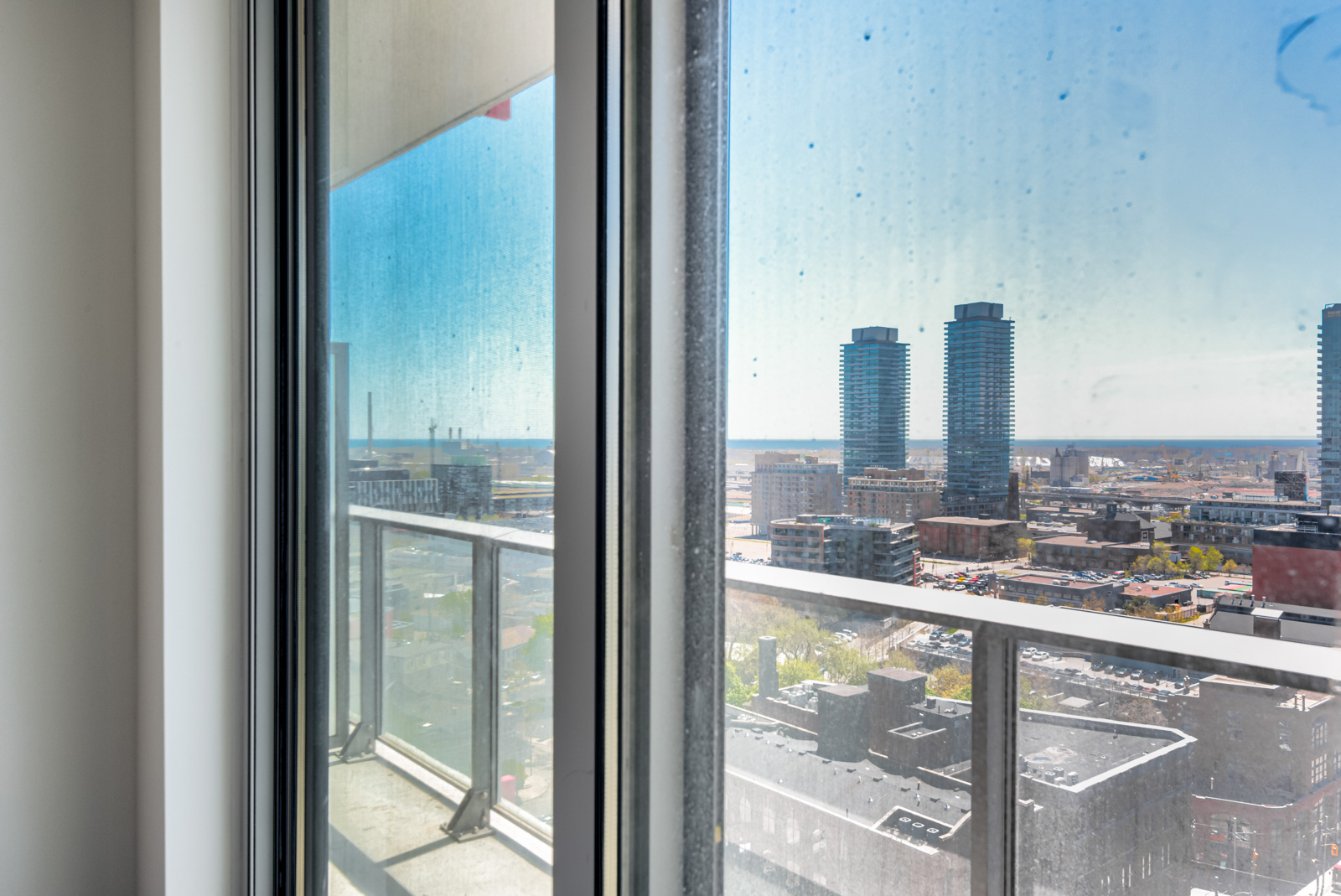 View of Toronto and Lake Ontario from 120 Parliament St Suite 1610 master bedroom.