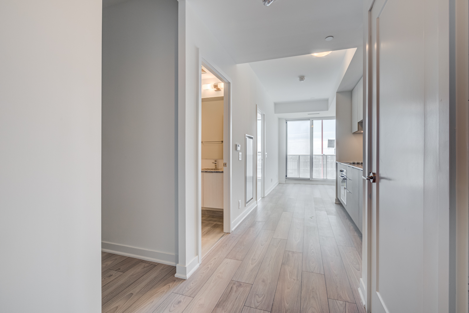 View of 120 Parliament St's linear kitchen and living room.