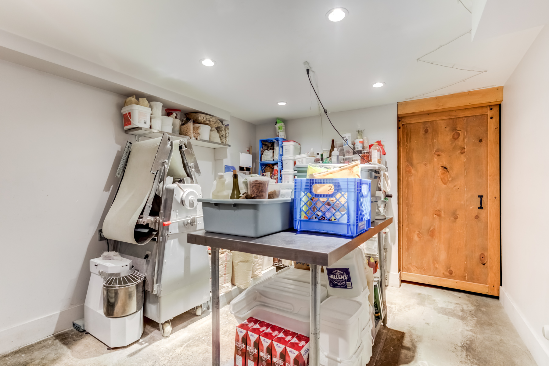 Basement storage room with food items.