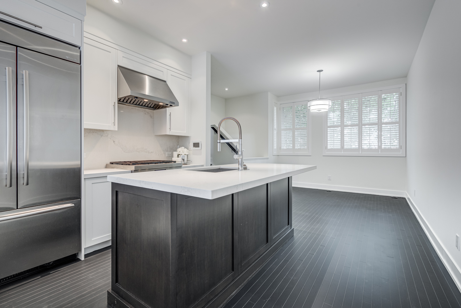 kitchen island with black base and white counters