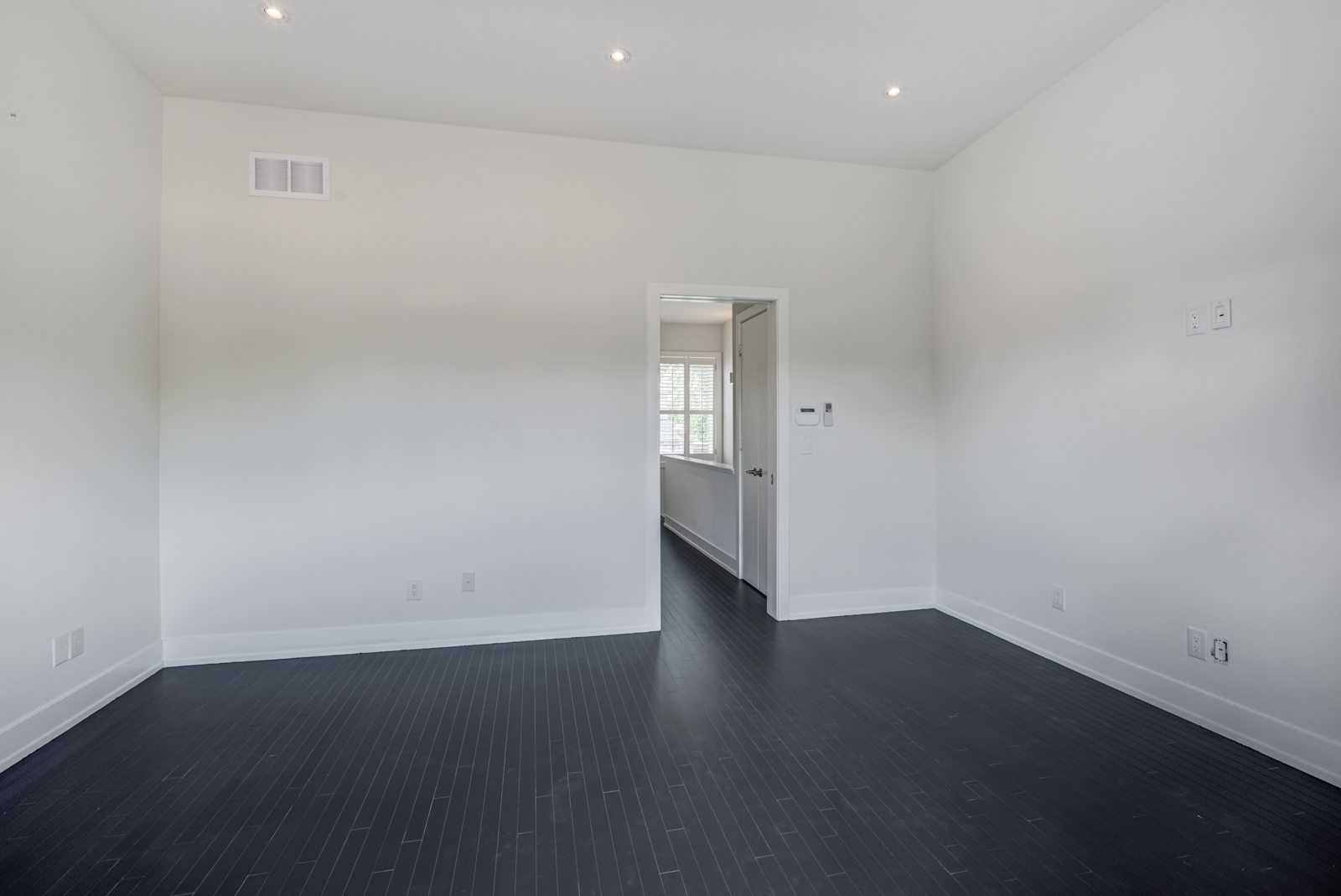 Huge empty master bedroom of 12A Cecil St