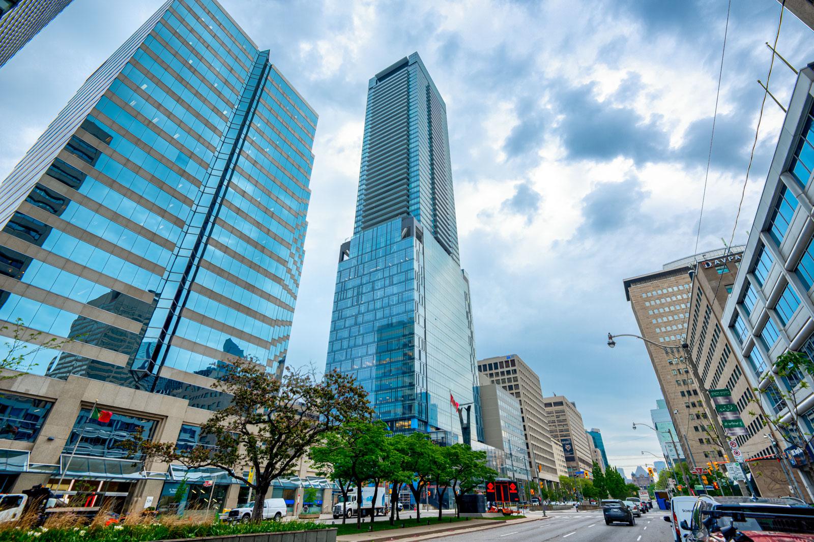 Shiny blue glass exterior of 488 University Avenue in Toronto.