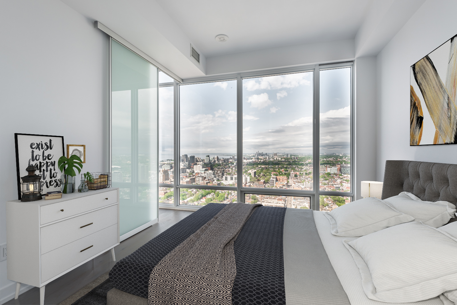 Huge window with Lake Ontario view from 488 University Ave Unit 3410 master bedroom.