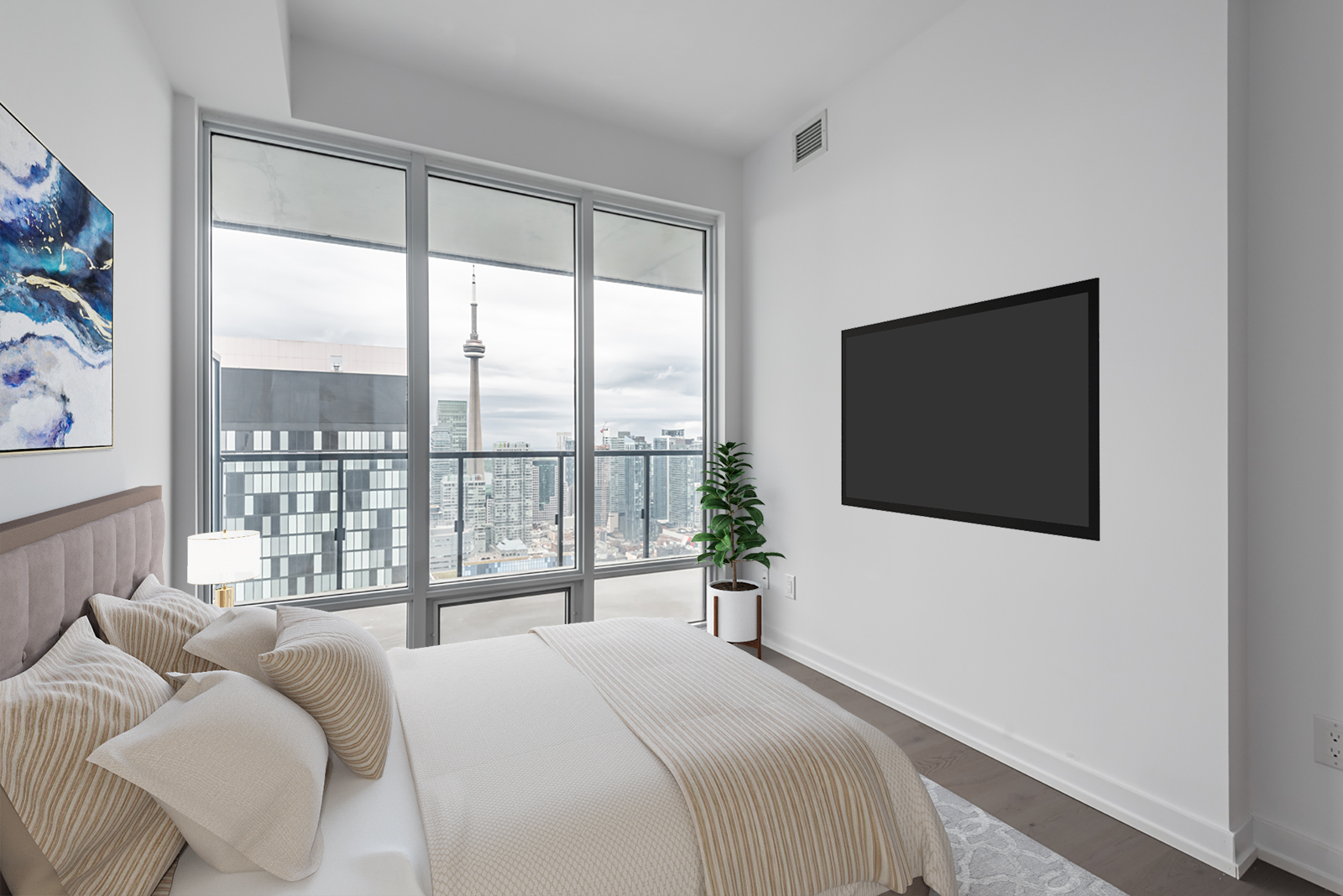 Condo bedroom with view of CN Tower.