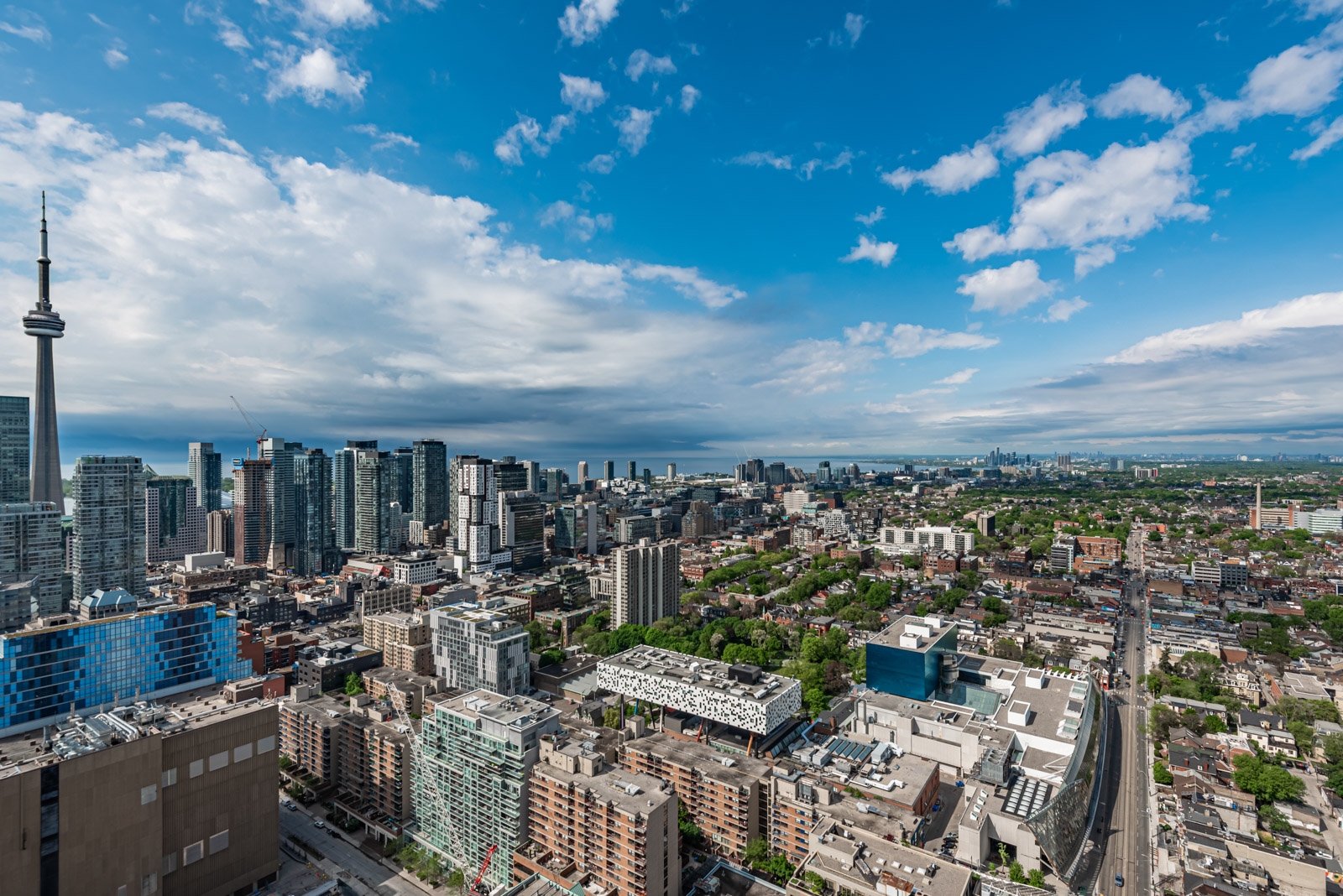 Daytime view of CN Tower, OCAD and Lake Ontario from 488 University Ave Unit 3410 balcony.