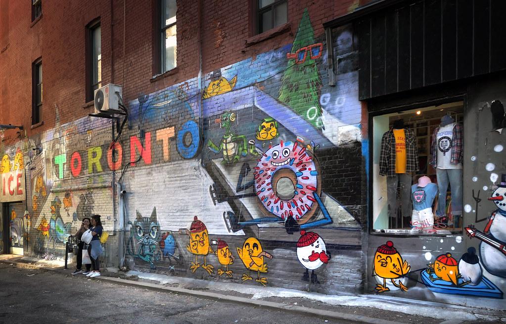Graffiti of cute birds and animals in Graffiti Alley, Toronto.