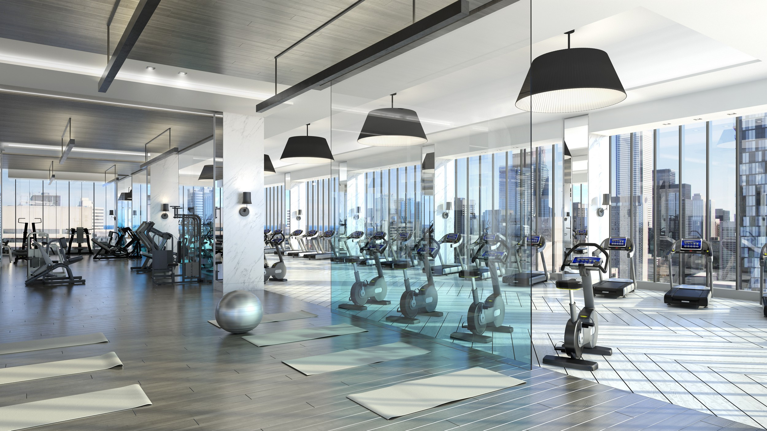3d image of gym with exercise bikes, ball and yoga mats at The Residences of 488 University Avenue.
