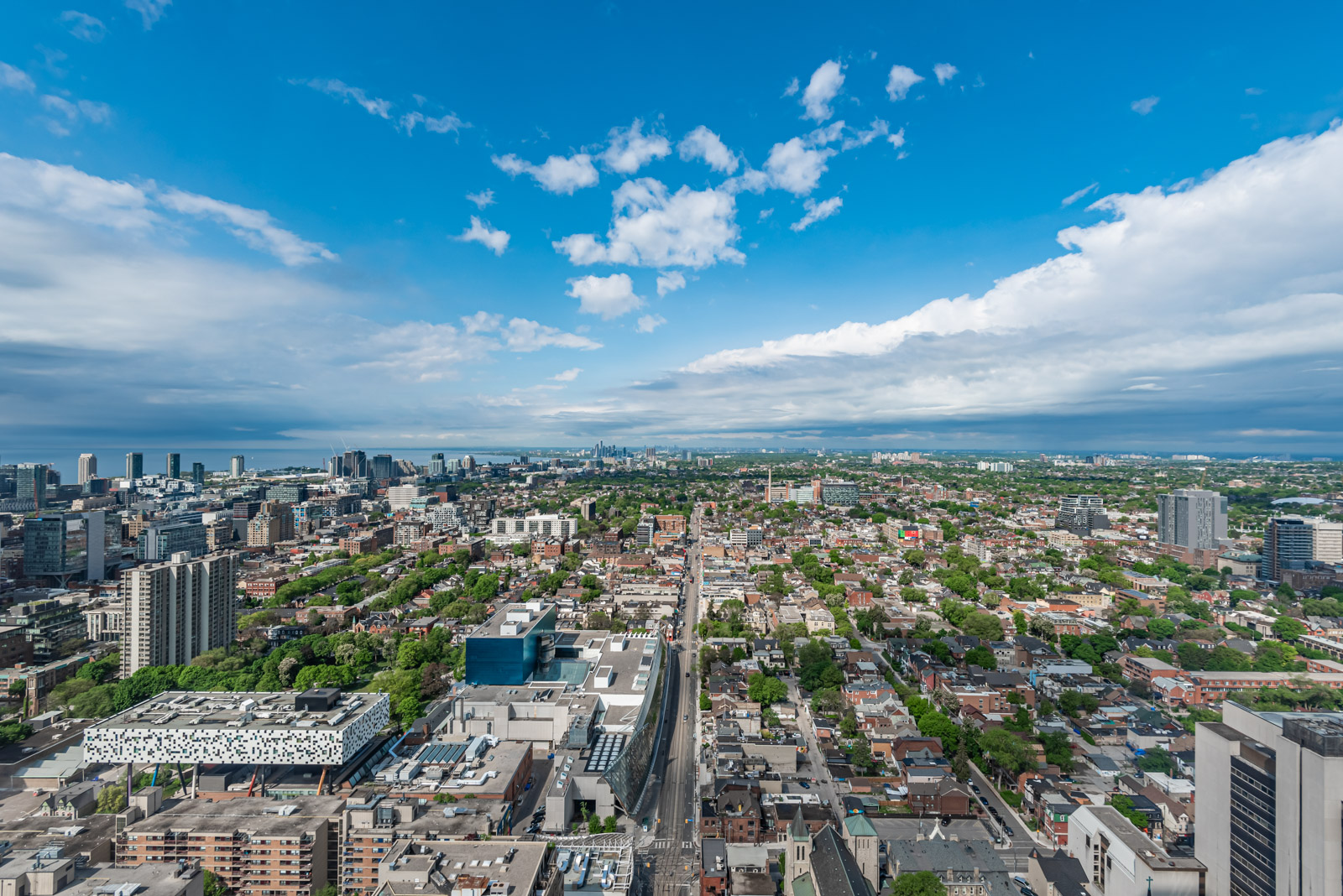 Aerial view of downtown Toronto from balcony of 488 University Ave Unit 3410.