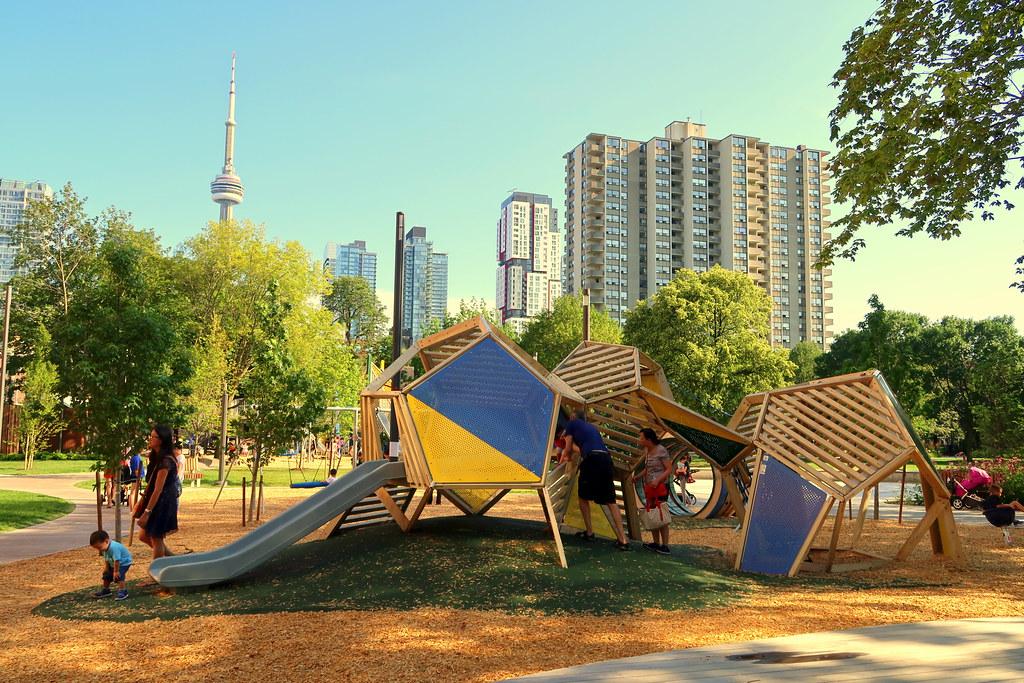 Kids playing at new playground of Grange Park, Toronto.
