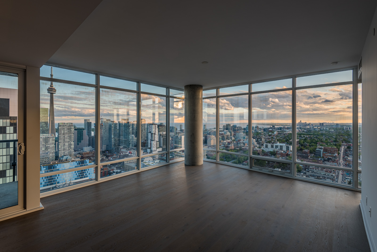 Empty condo and view of Toronto from 488 University Ave Unit 3410 living room.