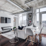 Open-concept living and dining room of 150 Sudbury St 511.