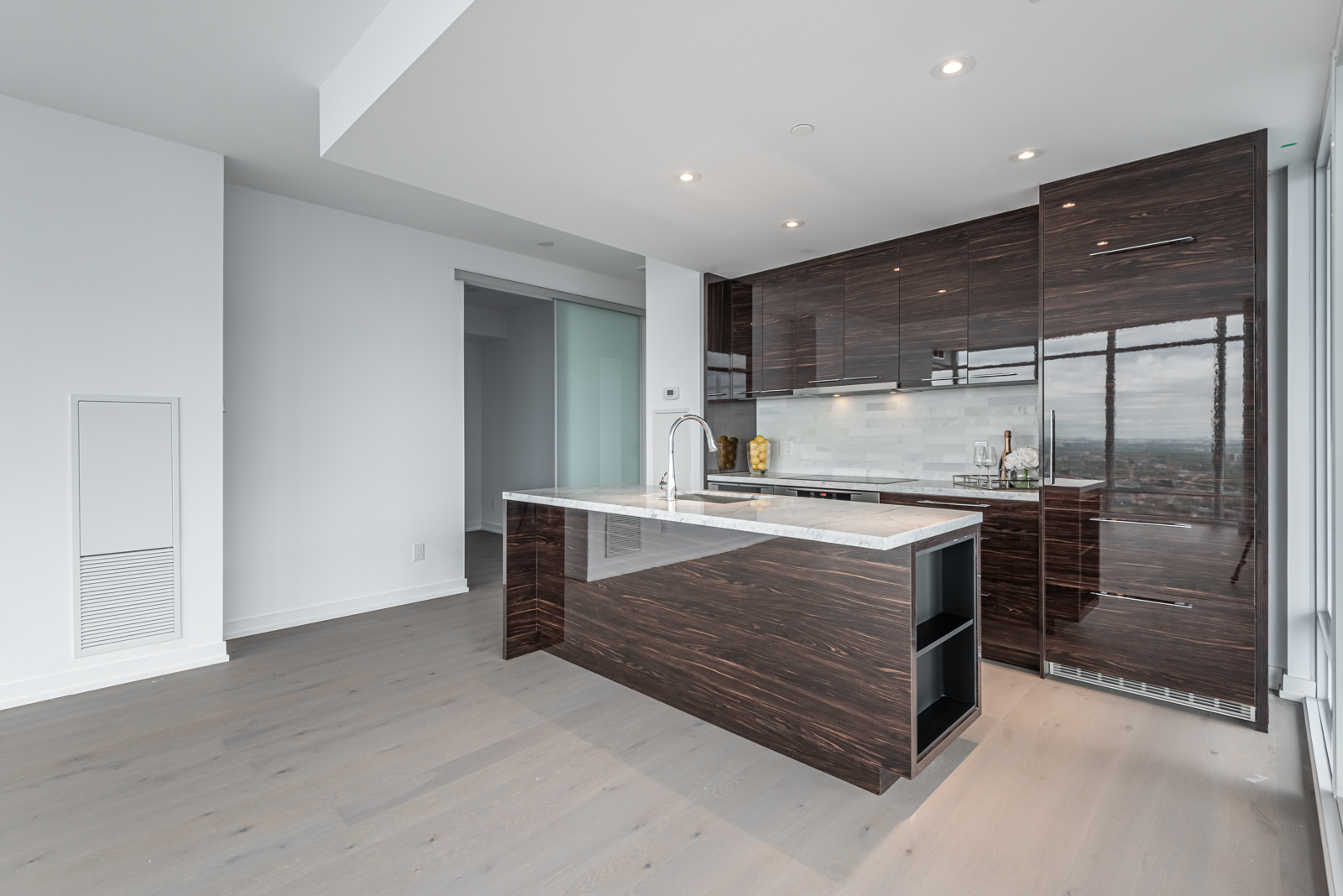 488 University Ave kitchen with gleaming dark brown cabinets and drawers.