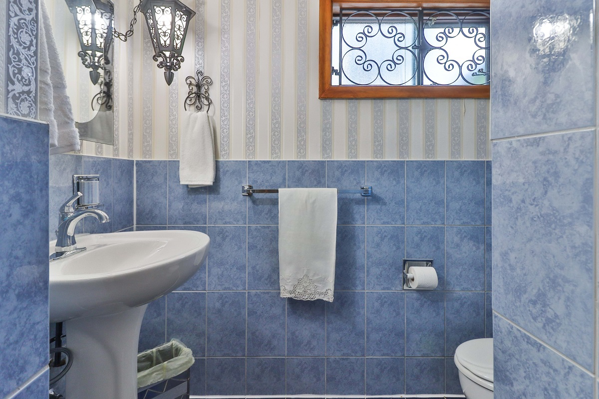 Basement bathroom with chic blue tiles, gray wallpaper and walk-in shower - 6 Parmbelle Cres