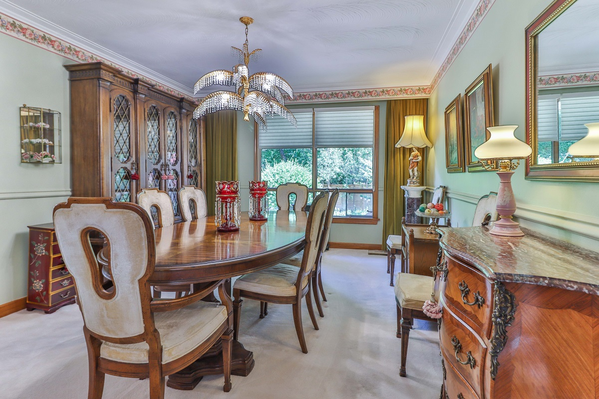 6 Parmbelle Cres dining room with huge cabinets, hutches and sideboard with fruits and lamps.