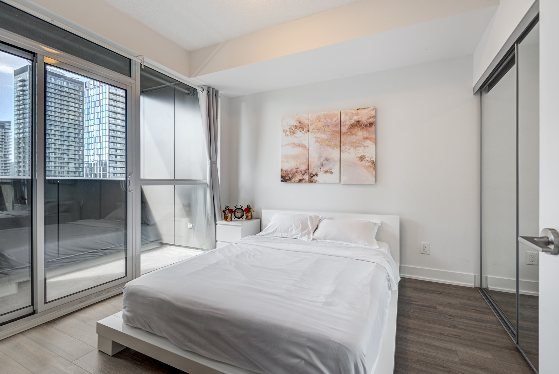 318 Richmond Unit 2607 large master bedroom with bed and balcony access.