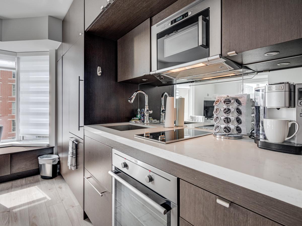 Close up of 155 Yorkville Ave Unit 1614 kitchen back-splash and under-cabinet lights.