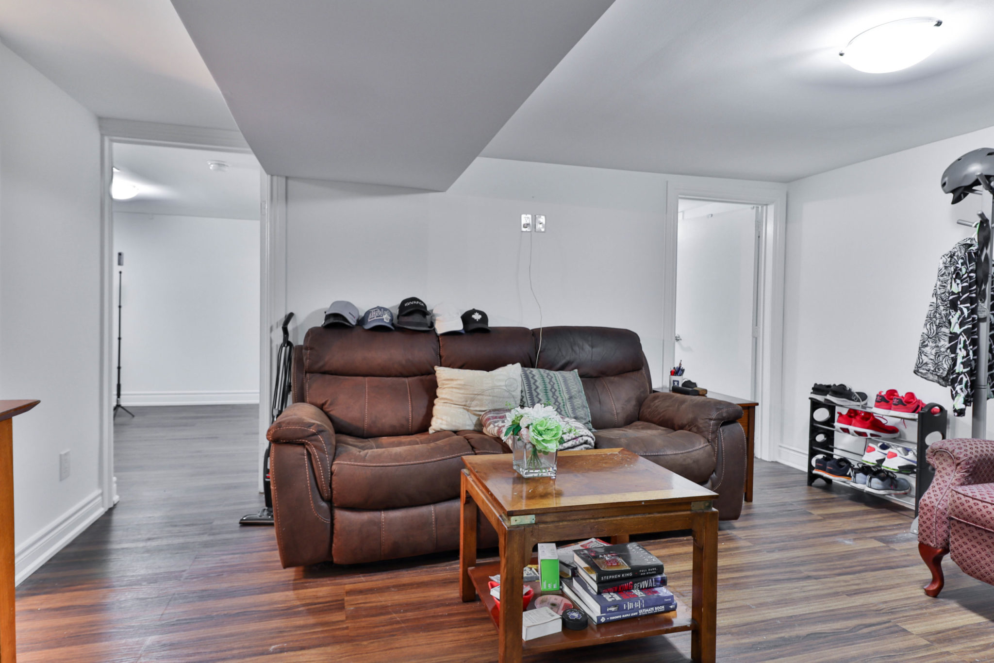 117 Phillip Ave finished basement with laminate floors, gray walls and ceiling lamps.