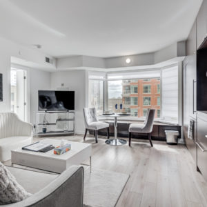 View of 155 Yorkville Ave Unit 1614 elegant living room and dining room.