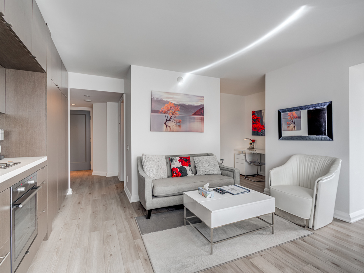 Gorgeous open-concept living room and kitchen of 155 Yorkville Unit 1614.