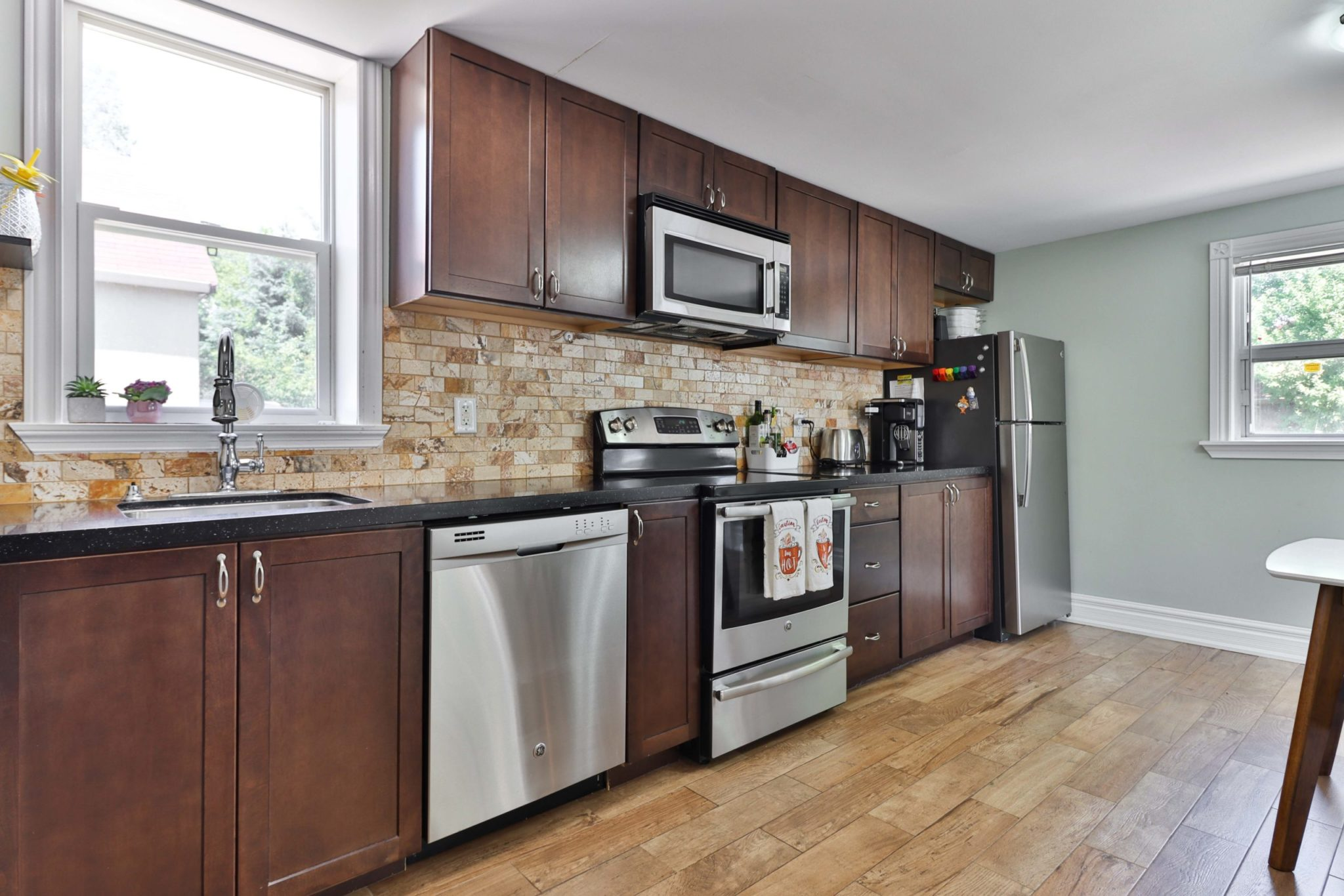 Large kitchen of 117 Phillip Ave with lots of drawers, cabinets and cupboards.