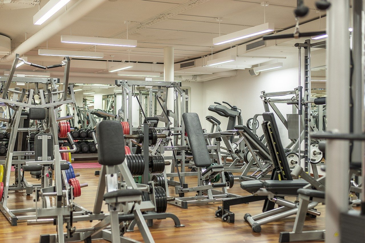 Gym equipment including weights and treadmills.