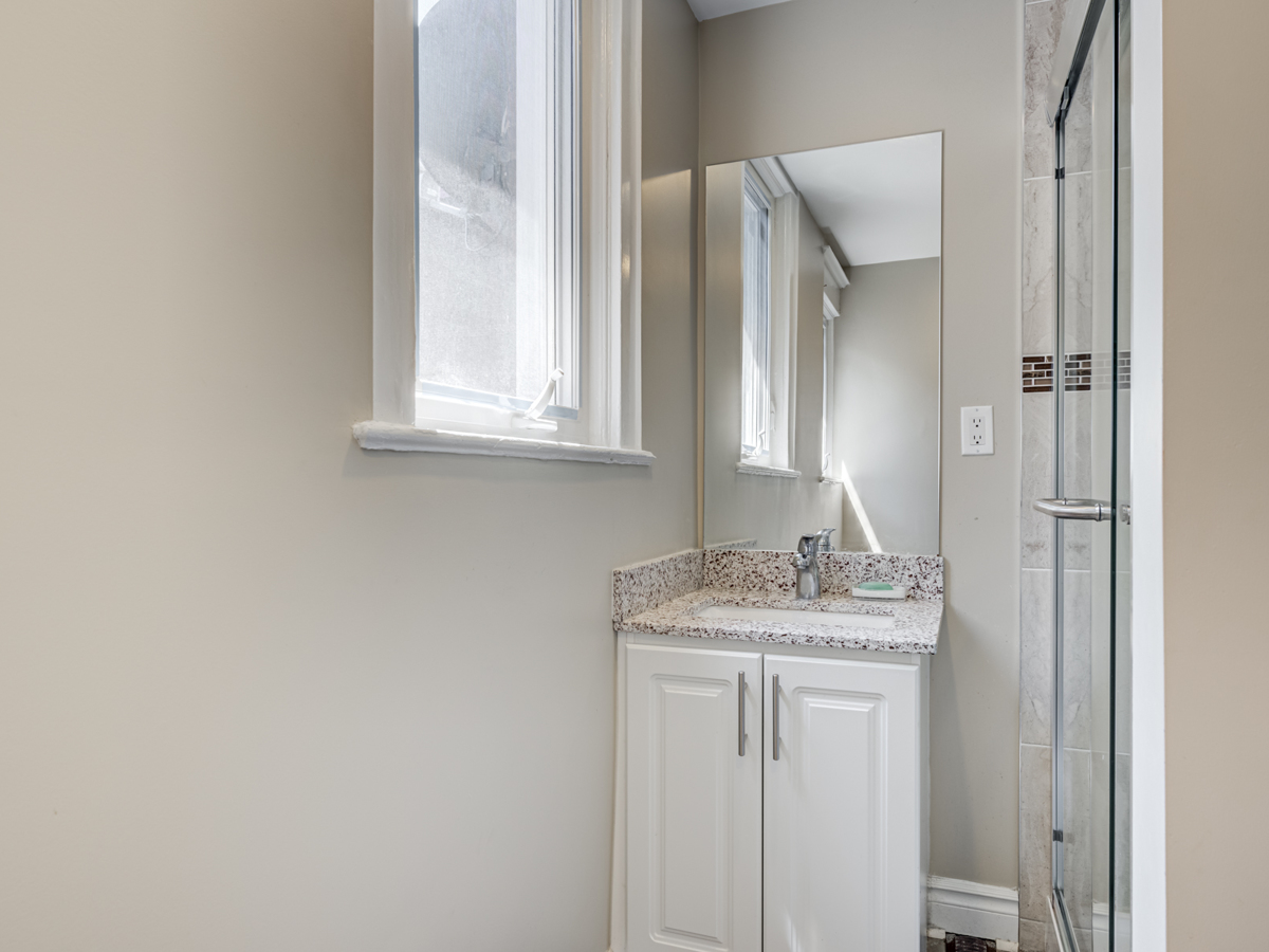51 Rusholme Park Crescent second floor bath with standing shower, vanity and pot-lights.