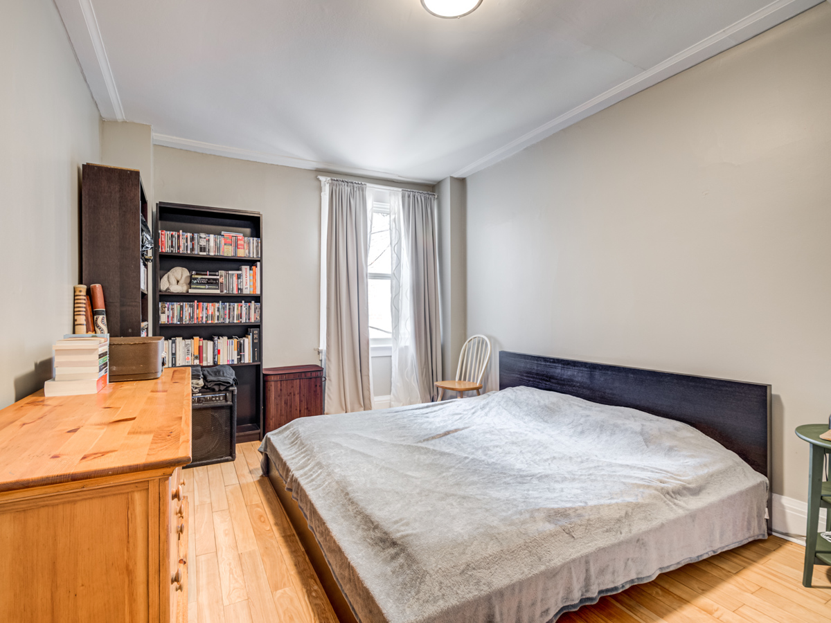 51 Rusholme Park Crescent bedroom with hardwood floors and large windows.