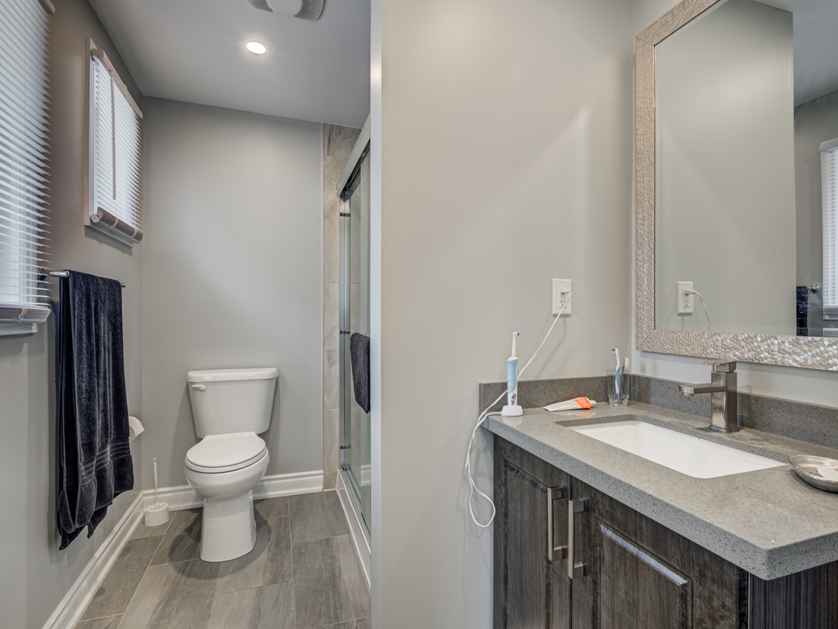 Beautiful bathroom with gray colour scheme and walk-in shower.