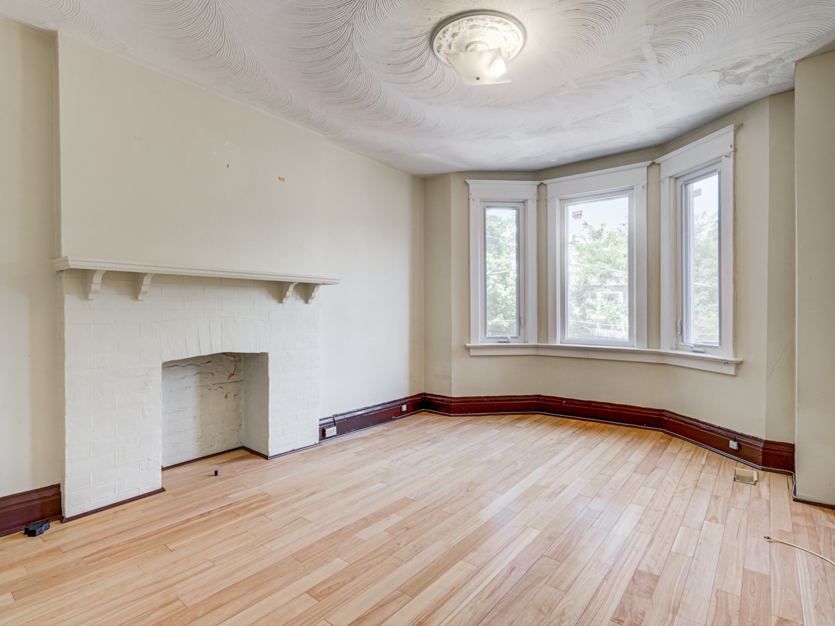 Empty second floor bedroom with large windows and hardwood floors at 51 Rusholme Park Crescent.