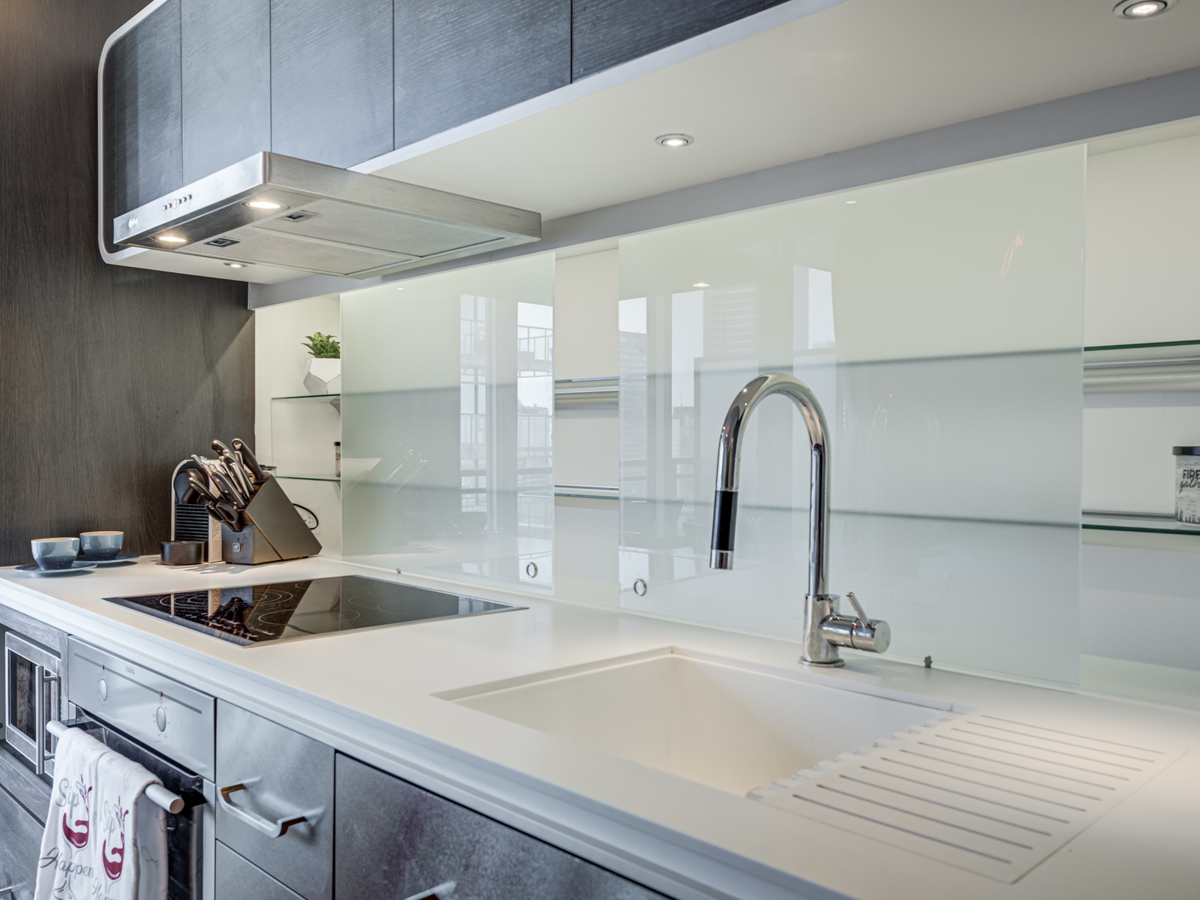 Frosted back-splash with sliding doors containing hidden glass shelves.