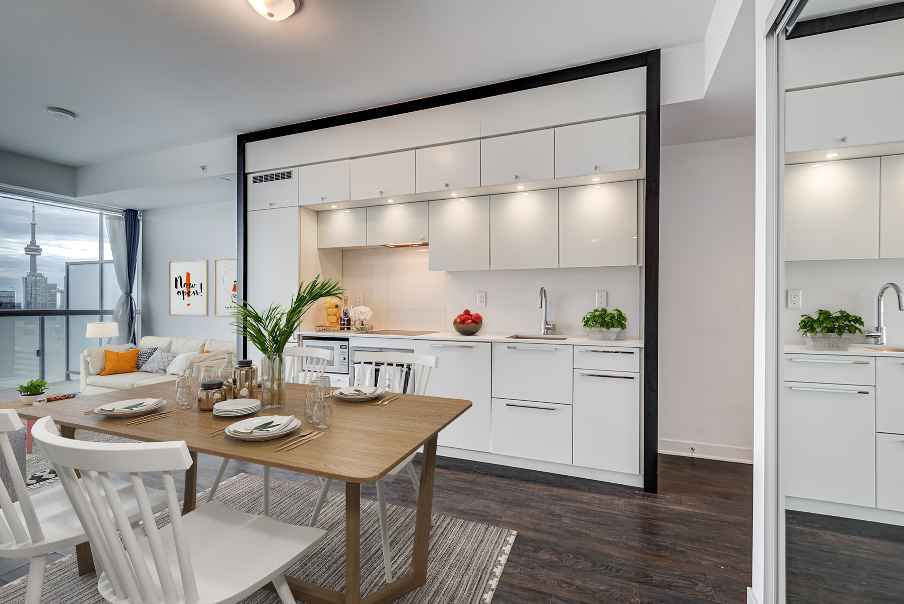 15 Grenville St Suite 4101 kitchen with 3D rendered furniture and CN Tower view.