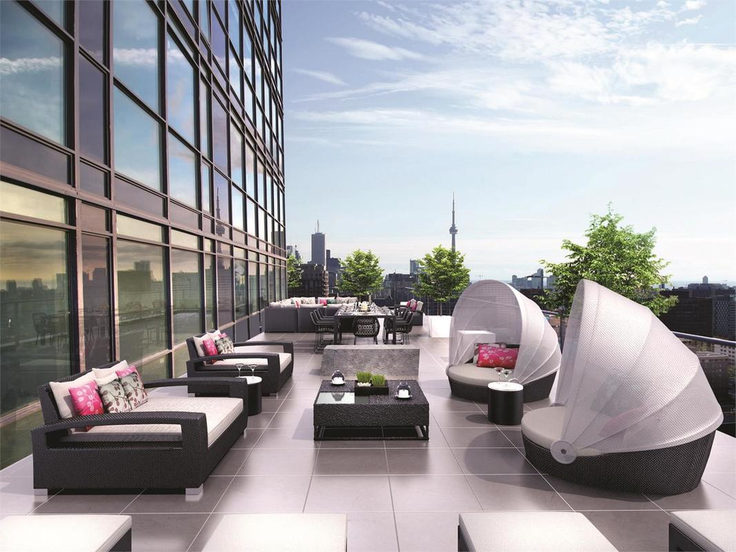 3D render of Pears on The Avenue rooftop deck amenity with CN Tower in background.