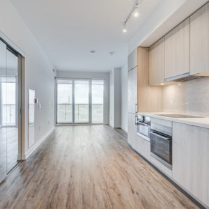 Open-concept condo with floor-to-ceiling windows.